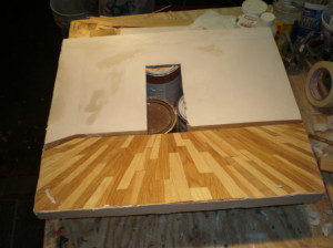 The veneer is bonded and the first coat of plaster is on the wall