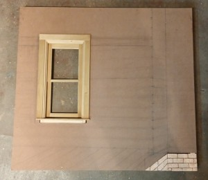 Hardboard is cut out and window installed